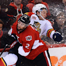 Ottawa Senators' Jared Cowen (2) slams Florida Panthers' Scottie Upshall into the boards during the third period of an NHL hockey game in Ottawa, Ontario, on Saturday, Nov. 9, 2013 The Associated Press