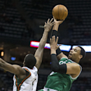 Milwaukee Bucks' Ekpe Udoh tries to block Boston Celtics' Jared Sullinger's shot during the first half of an NBA basketball game, Monday, Feb. 10, 2014, in Milwaukee The Associated Press