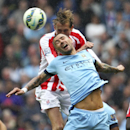 Stoke City's Peter Crouch and Manchester City's Edin Dzeko, front, jump for the ball during their English Premier League soccer match at the Etihad Stadium, Manchester, England, Saturday Aug. 30, 2014. (AP Photo / Lynne Cameron, PA)