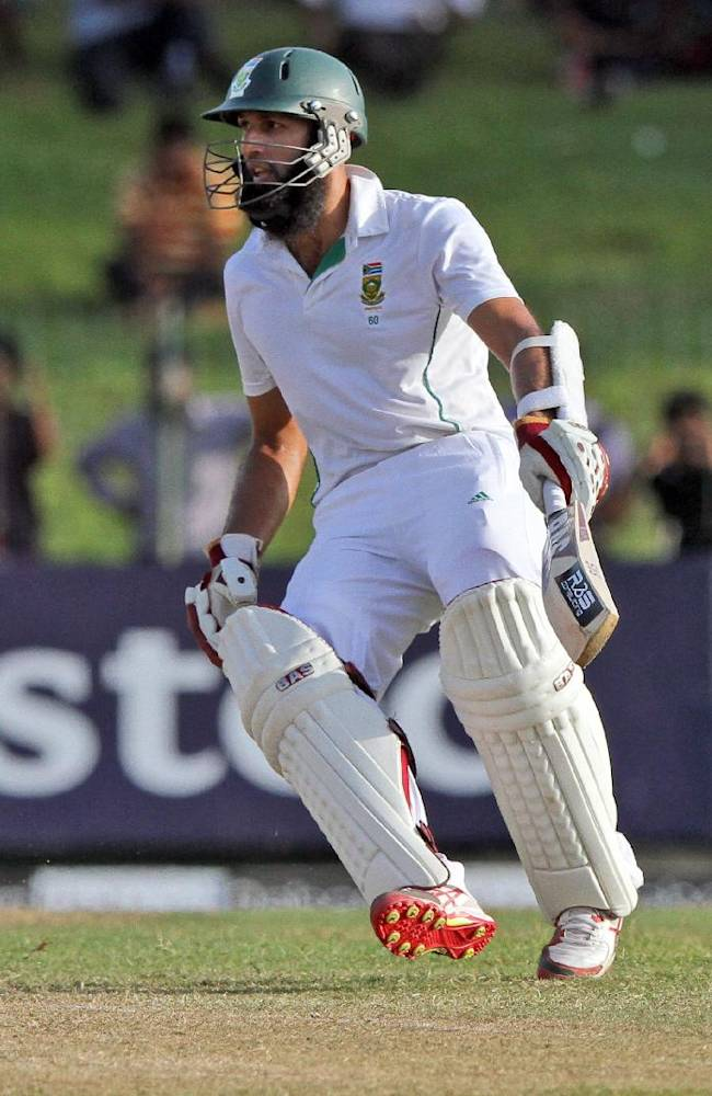South African cricketer Hashim Amla runs between the wickets during the second day of the second test cricket match between South Africa and Sri Lanka in Colombo, Sri Lanka, Friday, July 25, 2014