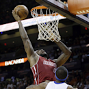 Miami Heat's LeBron James (6) shoots over Detroit Pistons' Josh Smith (6) during the first half of an NBA basketball game, Tuesday, Dec. 3, 2013, in Miami The Associated Press