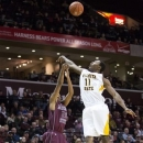 Wichita State forward Cleanthony Early (11) tries to block a shot by Missouri State forward Gavin Thurman (20) during the second half of an NCAA college basketball game on Wednesday, Jan. 23, 2013, in Springfield, Mo. Wichita State defeated Missouri State 62-52. (AP Photo/David Welker)