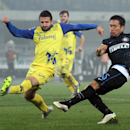 Inter Milan's Yuto Nagatomo, right, fires a shot past Chievo defender Alessandro Gamberini during a Serie A soccer match at the Bentegodi stadium in Verona, Italy, Monday, Dec. 15, 2014 The Associated Press