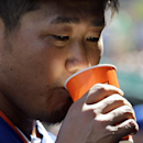 New York Mets starting pitcher Daisuke Matsuzaka takes a drink after working during the second inning of an exhibition baseball game against the St. Louis Cardinals on Sunday, March 2, 2014, in Jupiter, Fla. Matsuzaka allowed one run and two hits in two i