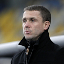 Dynamo Kiev's coach Serhiy Rebrov awaits the start of the Europa League Group J soccer match between Dynamo Kiev and Rio Ave at the Olympiyskiy national stadium in Kiev, Ukraine, Thursday, Nov. 27, 2014 The Associated Press