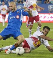 New York Red Bulls' Wilman Conde, right, tackles Montreal Impact's Marco Di Valo during the second half of an MLS soccer game Saturday, July 28, 2012, in Montreal. Montreal won 3-1. (AP Photo/The Canadian Press, Peter McCabe)