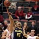 California guard Layshia Clarendon (23) scores and draws a foul from Washington State center Carly Noyes, obscured, as guard Katie Grad (4) watches during the first half of an NCAA college basketball game, Thursday, Feb. 28, 2013, at Beasley Coliseum in Pullman, Wash. (AP Photo/Dean Hare)