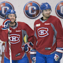 Montreal Canadiens' David Desharnais, left, and Max Pacioretty chat during a practice session in Brossard, Quebec, Monday, April 21, 2014. The Canadiens lead Tampa Bay 3-0 in their best-of-seven series in the first round of the playoffs The Associated Pr