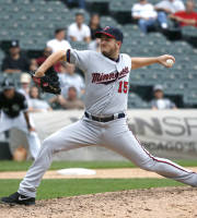 Minnesota Twins relief pitcher Glen Perkins delivers during the ninth inning of a baseball game against the Chicago White Sox on Wednesday, Sept. 18, 2013, in Chicago. (AP Photo/Charles Rex Arbogast)