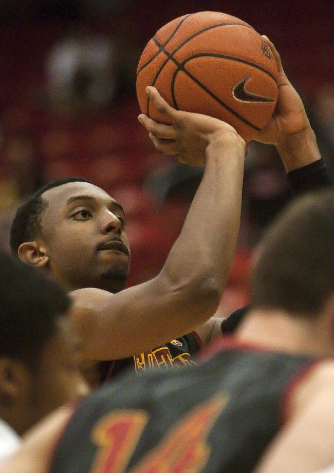 Southern California guard Byron Wesley shoots a free throw against Washington State during the second half of an NCAA college basketball game Thursday, March 6, 2014, at Beasley Coliseum in Pullman, Wash. Wesley led all scorers with 31 points and grabbed 10 rebounds to lead Southern California to a 79-68 victory