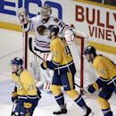 Nashville Predators forward Patric Hornqvist (27), of Sweden; Mattias Ekholm (42), of Sweden; and Mike Fisher (12) skate past Chicago Blackhawks goalie Antti Raanta (31), of Finland, after Hornqvist scored the go-ahead goal with less than a minute remaini
