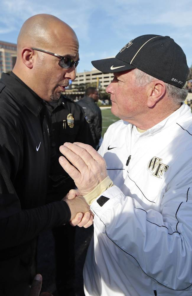 Vanderbilt head coach James Franklin, left, is congratulated by Wake Forest head coach Jim Grobe, right, after an NCAA college football game on Saturday, Nov. 30, 2013, in Nashville, Tenn. Vanderbilt won 23-21