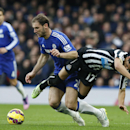 Newcastle United's Ayoza Perez, right, falls under the challenge of Chelsea's Branislav Ivanovic during the English Premier League soccer match between Chelsea and Newcastle United at Stamford Bridge stadium in London, Saturday, Jan. 10, 2015
