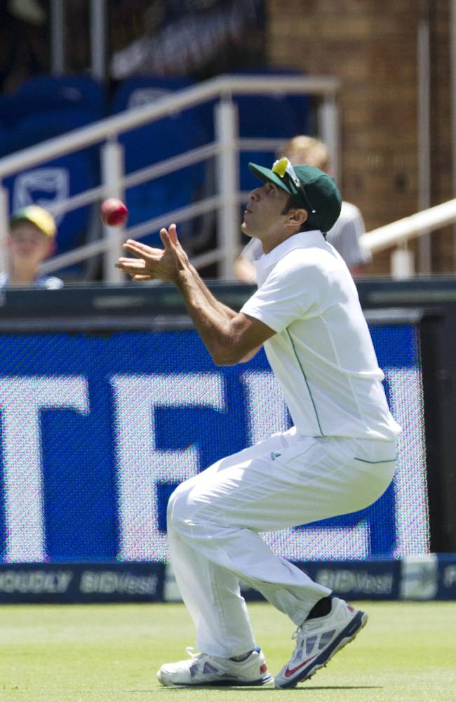 South Africa's fielder Imran Tahir takes a catch to dismiss India's Shikhar Dhawan for 13 runs during the first day of their cricket test match at Wanderers stadium in Johannesburg, South Africa, Wednesday, Dec. 18, 2013