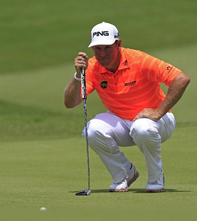Lee Westwood of England lines up his putt on the seventh green during the third round of the Malaysian Open golf tournament at Kuala Lumpur Golf and Country Club in Kuala Lumpur, Malaysia, Saturday, April 19, 2014