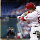 Philadelphia Phillies' Chase Utley follows through on his swing for an RBI-double scoring Jimmy Rollins from first during the first inning of a baseball game against the Miami Marlins, Saturday, April 12, 2014, in Philadelphia The Associated Press