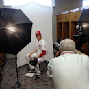 Cincinnati Reds starting pitcher Homer Bailey, left, poses as Cincinnati Enquirer photographer Gary Landers takes his picture during the team photo day before a spring training baseball workout Thursday, Feb. 20, 2014, in Goodyear, Ariz The Associated Pre