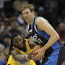 Denver Nuggets forward Kenneth Faried (35) lunges for the ball controlled by Dallas Mavericks forward Dirk Nowitzki (41) in the third quarter of an NBA game in Denver on Wednesday, March 5, 2014. Denver won 115-110 The Associated Press