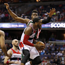 Washington Wizards guard John Wall (2) drives past Milwaukee Bucks forward Jeff Adrien during the second half of an NBA basketball game, Saturday, April 12, 2014, in Washington. Wall had 15 points. The Wizards won 104-91 The Associated Press