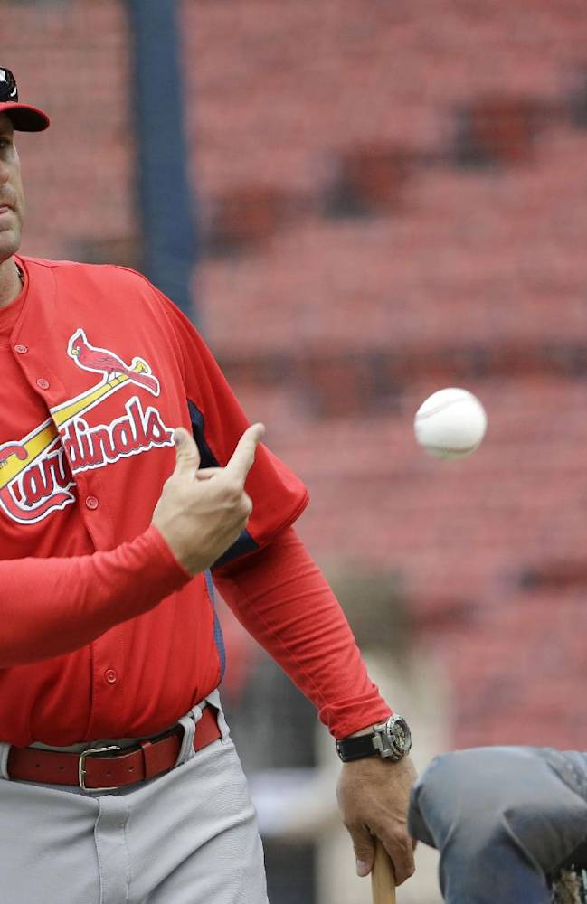 St. Louis Cardinals manager Mike Matheny tosses a ball during batting practice for Game 1 of baseball's World Series against the Boston Red Sox Tuesday, Oct. 22, 2013, in Boston