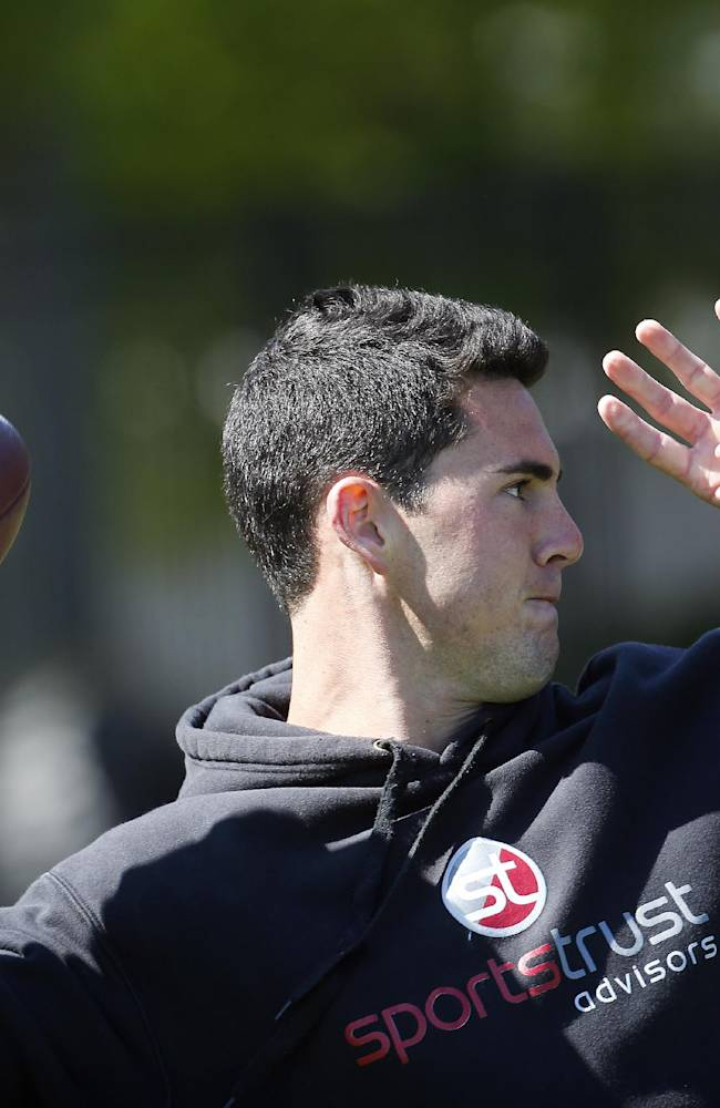 Georgia quarterback Aaron Murray works out for NFL football scouts during the school's pro day Wednesday, April 16, 2014 in Athens, Ga
