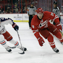 Carolina Hurricanes' Riley Nash (20) and Columbus Blue Jackets' Trent Vogelhuber (76) chase the puck during the first period of an NHL preseason hockey game in Raleigh, N.C., Sunday, Sept. 21, 2014 The Associated Press
