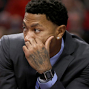 Chicago Bulls guard Derrick Rose watches his team from the bench during the second half of an NBA basketball game against the Portland Trail Blazers Friday, March 28, 2014, in Chicago. The Trail Blazers won 91-74 The Associated Press