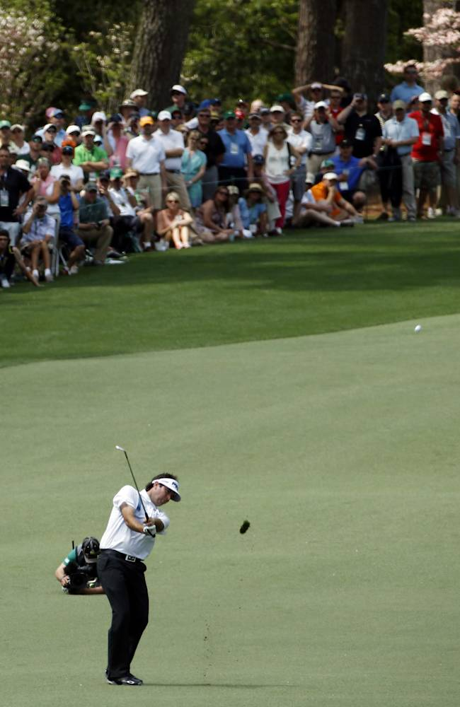Bubba Watson hits off the second fairway during the fourth round of the Masters golf tournament Sunday, April 13, 2014, in Augusta, Ga