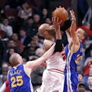 Chicago Bulls forward Taj Gibson (22) is fouled by Golden State Warriors guard Steve Blake (25) as Stephen Curry (30) also defends during the first half of an NBA basketball game, Wednesday, Feb. 26, 2014, in Chicago The Associated Press