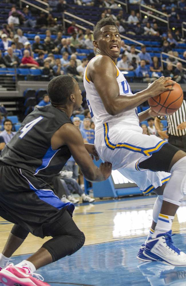 UCLA's Jordan Adams, right, defended by Cal State San Bernardino's Larry Thompkins III (4) in the second half of an NCAA college exhibition  basketball game on Wednesday, Oct. 30, 2013, in Los Angeles