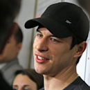 Pittsburgh Penguins captain Sidney Crosby answers a reporter's question in the Penguins' locker room during locker clean out day at the Consol Energy Center in Pittsburgh, Thursday, May 15, 2014. (AP Photo/Gene J. Puskar)
