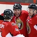 Ottawa Senators Cody Ceci, center, celebrates his first NHL goal with teammates Chris Phillips (4) and Milan Michalek(9) in overtime NHL action to beat St Louis Blues 3-2, in Ottawa Monday, Dec.16, 2013. (AP Photo/The Canadian Press, Fred Chartrand)