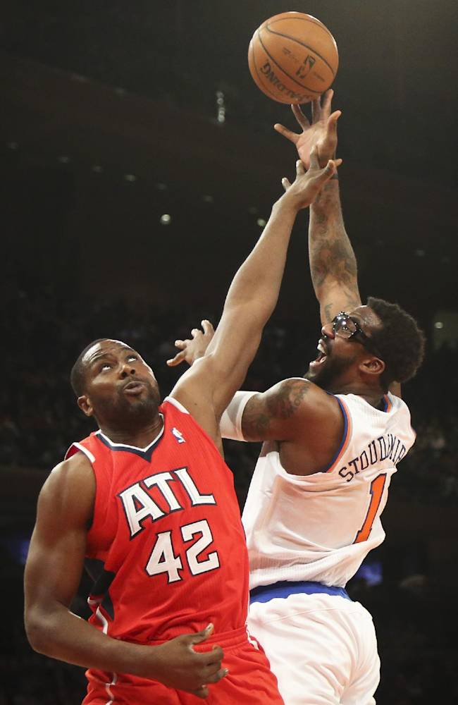 New York Knicks forward Amar'e Stoudemire (1) shoots over Atlanta Hawks forward Elton Brand (42) during the first half of an NBA basketball game Saturday, Dec. 14, 2013, in New York. The Knicks won 111-106
