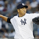 As Cano nears leaving Yanks, RHP Kuroda stays The Associated Press