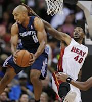 Charlotte Bobcats guard Gerald Henderson (9) rebounds against Miami Heat forward Udonis Haslem (40) during the second quarter of a preseason NBA basketball game in Kansas City, Mo., Friday, Oct. 11, 2013. (AP Photo/Orlin Wagner)