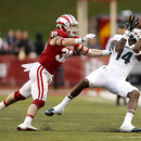 Michigan State wide receiver Tony Lippett (14) hauls in a pass against Indiana safety Chase Dutra (30) during an NCAA college football game in Bloomington, Ind., Saturday, Oct. 18, 2014. Michigan State won the game 56-17. (AP Photo/Sam Riche)
