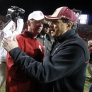 North Carolina State coach Tom O'Brien, left, greets Boston College coach Frank Spaziani after N.C. State's 27-10 victory in an NCAA college football game Saturday, Nov. 24, 2012, in Raleigh, N.C. (AP Photo/The News & Observer, Ethan Hyman)