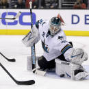 San Jose Sharks goalie Antti Niemi makes a save against the Los Angeles Kings during the second period of an NHL hockey game in Los Angeles, Thursday, Dec. 19, 2013. (AP Photo/Chris Carlson)