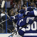 Tampa Bay Lightning players, from left, Nikita Kucherov (86), of Russia, Ben Bishop (30), Victor Hedman (77), of Sweden, and Tyler Johnson celebrate their 2-0 win over the Detroit Red Wings in Game 7 of a first-round NHL Stanley Cup hockey playoff series Wednesday, April 29, 2015, in Tampa, Fla. (AP Photo/Chris O'Meara)