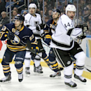 Buffalo Sabres' Tyler Ennis (63) and Zemgus Girgensons (28), of Latvia, battle along the boards against Los Angeles Kings' Robyn Regehr (44), of Brazil, and Drew Doughty (8) during the second period of an NHL hockey game Tuesday, Dec. 9, 2014, in Buffalo,