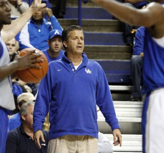 Kentucky head coach John Calipari watches his team during their Blue-White NCAA college basketball scrimmage, Tuesday, Oct. 29, 2013, in Lexington, Ky. The Blue team won 99-71
