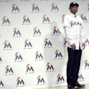 Miami Marlins' Ichiro Suzuki in his new uniform and cap poses for photos during a news conference in Tokyo, Thursday, Jan. 29, 2015. Ichiro passed his physical and finalized a $2 million, one-year contract with the Miami Marlins. The Marlins made the anno