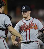 Atlanta Braves catcher Brian McCann (16) celebrates 6-3 win over the Washington Nationals with teammate Craig Kimbrel, right, after a baseball game on Wednesday, Aug. 7, 2013, in Washington. (AP Photo/Nick Wass)