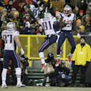 New England Patriots' Rob Gronkowski (87) watches as Brandon LaFell (19) celebrates his touchdown catch with Timothy Wright (81) during the second half of an NFL football game against the Green Bay Packers Sunday, Nov. 30, 2014, in Green Bay, Wis The Asso