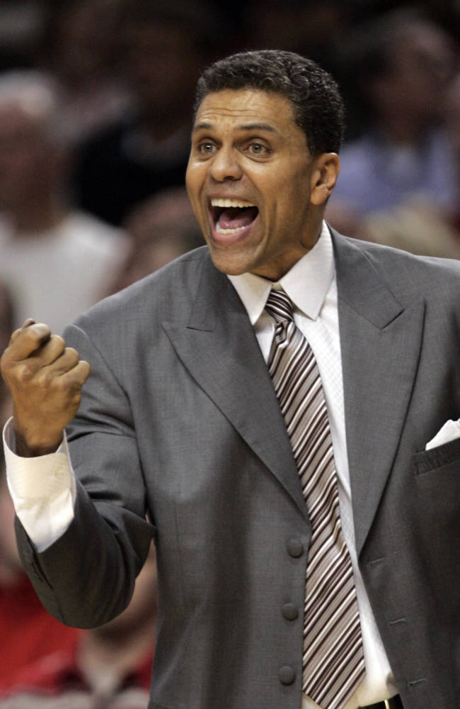 In this Feb. 19, 2008 file photo, Sacramento Kings head coach Reggie Theus yells instructions to his team during the second half of an NBA basketball game against the Portland Trail Blazers in Portland, Ore. Unlike new coaches at nearby UCLA and USC, two-time NBA All-Star and 56-year-old Theus was born and played his high school ball in the Los Angeles area. Theus is back where he wanted to be _ in college coaching