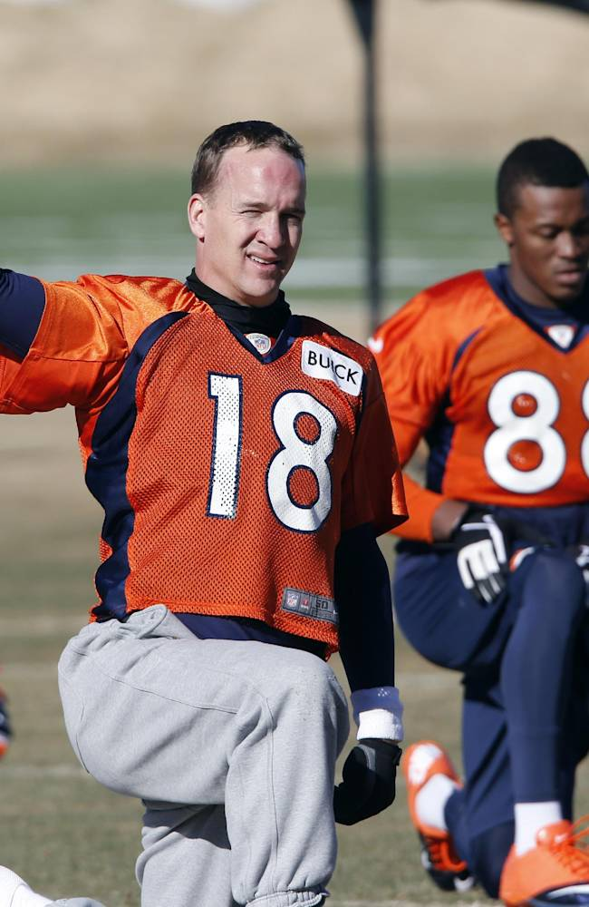 Denver Broncos quarterback Peyton Manning (18) stretches with wide receiver Demaryius Thomas (88) during NFL football practice at the team's training facility in Englewood, Colo., Saturday, Jan. 25, 2014. The Broncos are scheduled to play the Seattle Seahawks in Super Bowl XLVIII on Feb. 2