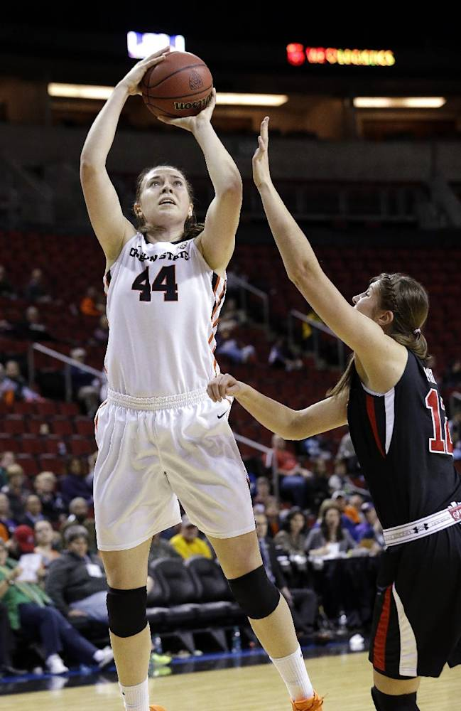 Oregon State's Ruth Hamblin (44) shoots over Utah's Emily Potter in the second half of an NCAA college basketball game in the Pac-12 women's tournament Friday, March 7, 2014, in Seattle. Oregon State won 50-35