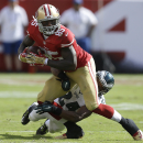 San Francisco 49ers tight end Vernon Davis (85) is tackled by Philadelphia Eagles cornerback Bradley Fletcher (24) during the third quarter of an NFL football game in Santa Clara, Calif., Sunday, Sept. 28, 2014. Davis was injured on the play The Associate