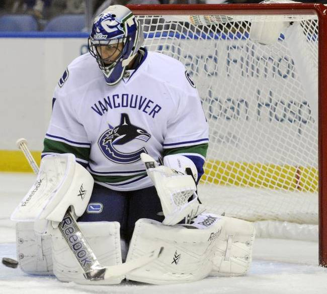 Vancouver Canucks goaltender Roberto Luongo makes a pad save during the first period of an NHL hockey game against the Buffalo Sabres in Buffalo, N.Y., Thursday, Oct. 17, 2013