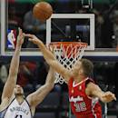 Los Angeles Clippers forward Blake Griffin (32) knocks a shot away from Memphis Grizzlies center Kosta Koufos (41) in the first half of an NBA basketball game on Thursday, Dec. 5, 2013, in Memphis, Tenn. (AP Photo/Lance Murphey)